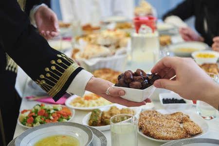 Muslim family starting iftar with dates during Ramadan