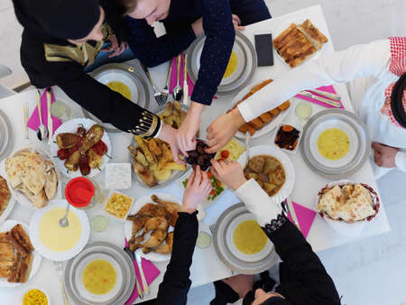 Top view of Muslim family having iftar together during Ramadan