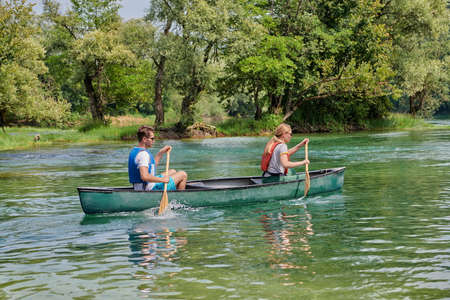 friends are canoeing in a wild river Stock fotó