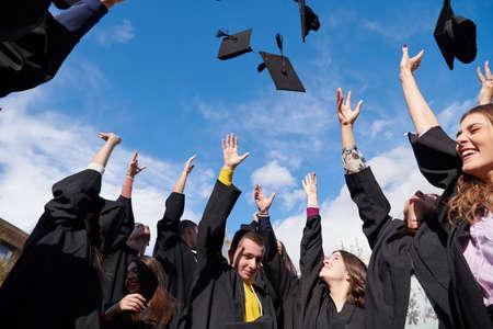 Group of diverse international graduating students celebrating