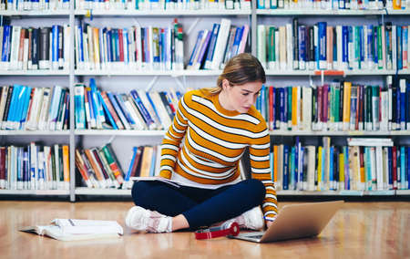 the student uses a notebook and a school library
