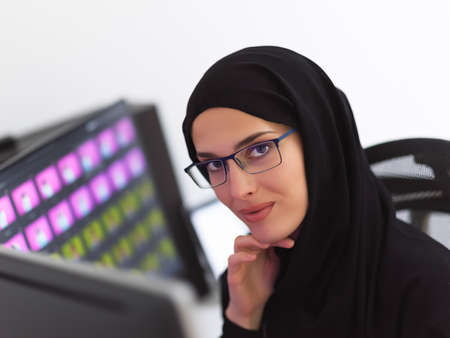 Portrait of young muslim female graphic designer with glasses