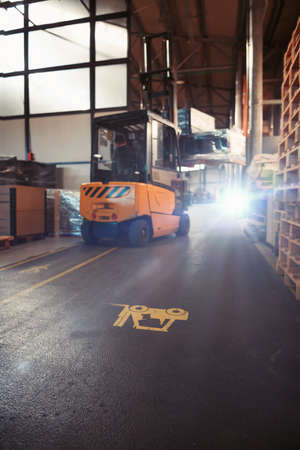 Forklift loader in storage warehouse ship yard. Distribution products. Delivery. Logistics. Transportation. Business background Foto de archivo