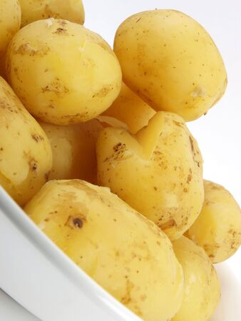 peal: potatoes close up on white background