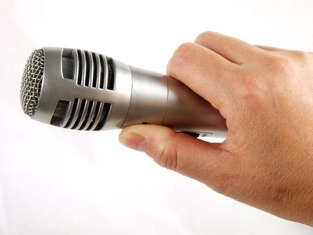 amplify: Hand holding microphone Stock Photo