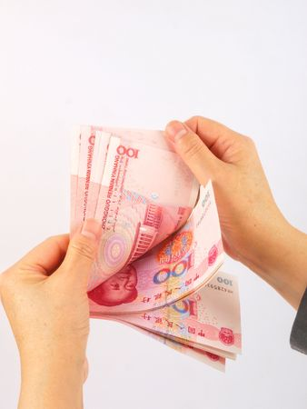 Hands holding Chinese money. Close up on white background