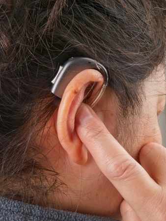 hearing aid: Woman wearing hearing aid