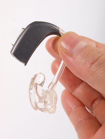 Hand holding hearing aid