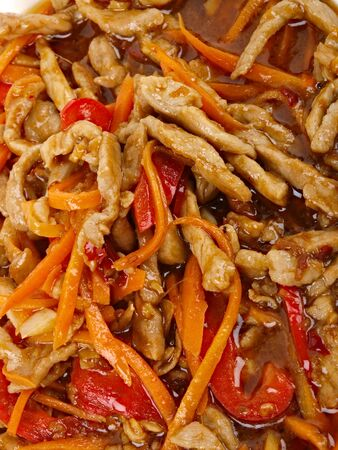 Chinese fried pork meat with pepper and carrot photo