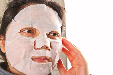 facemask: woman wearing a facemask  Stock Photo