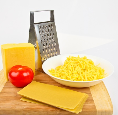 grated cheese and grater photo
