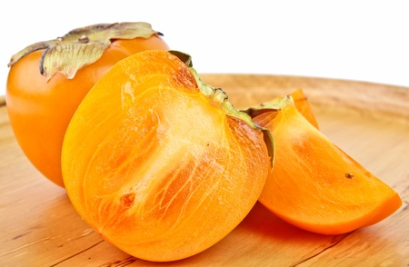 persimmon. Close up on white background