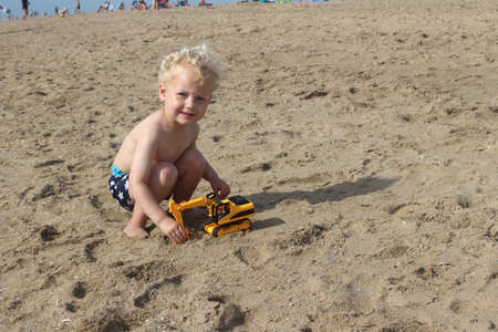 only one boy: Little Boy Playing On The Beach