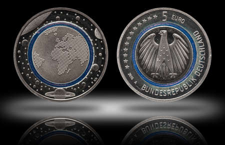 Germany five euro coin with planets and blue polymer ring Stock fotó