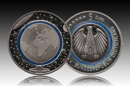 Germany five euro coin with planets and blue polymer ring Standard-Bild
