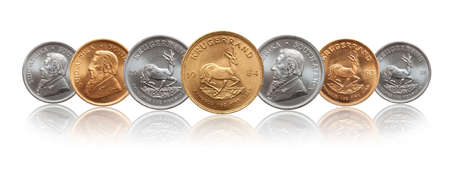 South African Krugerrand ounce silver and gold bullion coins 版權商用圖片