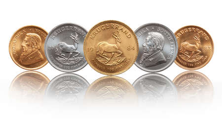 South African Krugerrand ounce silver and gold bullion coins Stock Photo