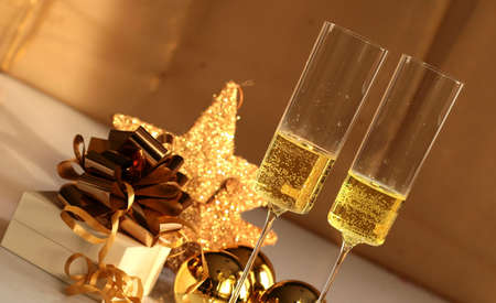 new year s eve: Glasses of champagne with christmas ornaments
