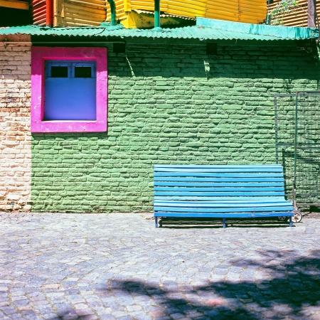 Blue bench against green wall, La Boca, Caminito, Buenos Aires Argentina Stok Fotoğraf