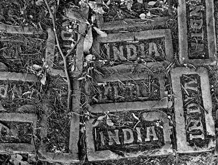Himalaya  Bhutan  Paro  Footpath, old bricks with India stamp  photo