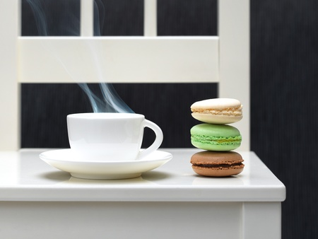 Three macaroon biscuits and hot drink photo