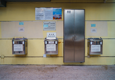 repulse: Repulse Bay, Hongkong - November 19, 2015: Stainless steel public drinking fountains mounted at wall