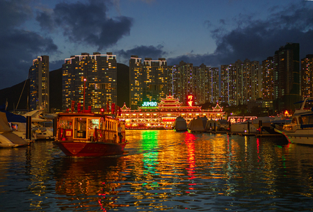 repulse: Repulse Bay, Hong Kong - November 19, 2015: The Jumbo Floating Restaurant can be found in Aberdeen Harbour in Hong Kong. The original Jumbo restaurant was burnt down before its opening in 1971.