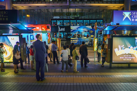 tramline: Hong Kong - November 19, 2015: People are using city tram at night. Hong Kong tram is the only in the world run with double deckers and one of the main tourist attractions.