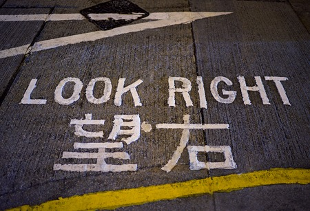 look right: Look right sign at night. Hong Kong