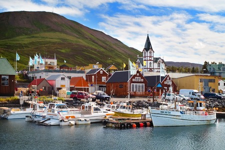 Husavik, Iceland - July, 2008: View of the historic town. Husavik is a town in Nordurping municipality on the north coast of Iceland. The wooden church Husavikurkirkja, built in 1907.