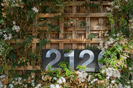 number plate: Stainless steel house number plate 2120 on a wood background. San Francisco - California Stock Photo