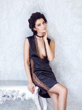 Beautiful brunette in black silk slip, Fashion style portrait.