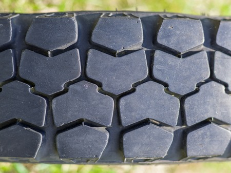 tread: Close-Up of old offroad vehicle tire tread
