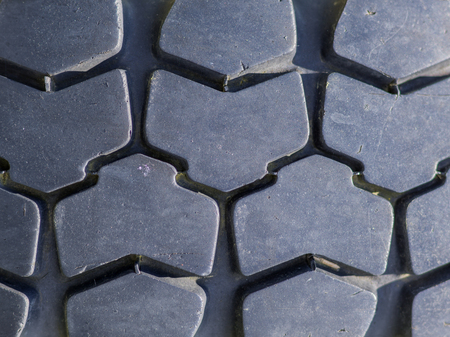 treads: Close-Up of old offroad vehicle tire tread