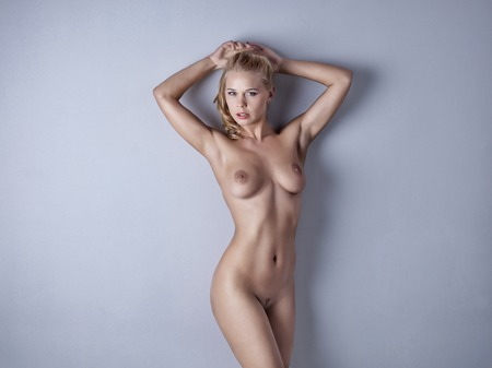 Sexy body nude woman. Naked sensual beautiful girl posing on the white background. Artistic photo.