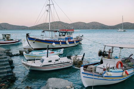 Traditional boats in the harbor of Elounda