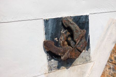 Closeup of old rusty anchor on a ship