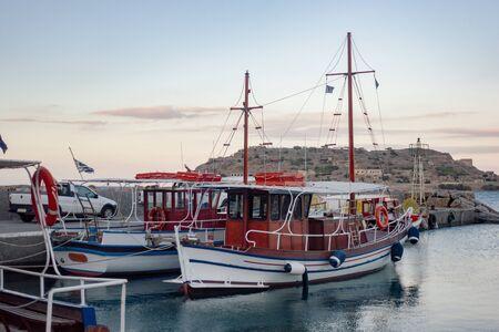 Touristic boat against Spinalonga island Stok Fotoğraf