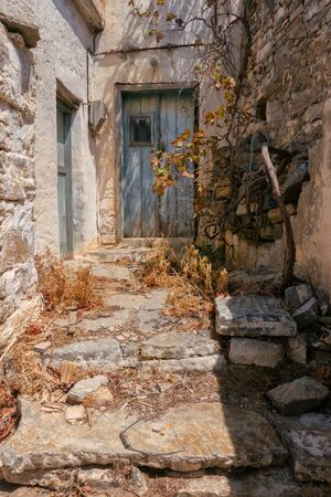 Entrance to a Greek house with a traditional blue door