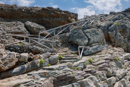 Stairs to Avlaki beach on Cretan sea Stok Fotoğraf
