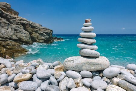 Pebble pyramid on Avlaki beach on Cretan sea