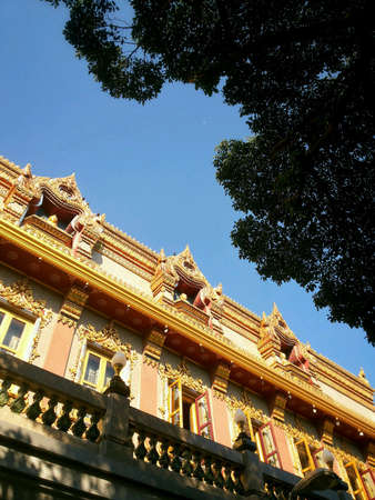 architecture: Thai temple architecture under blue sky and tree