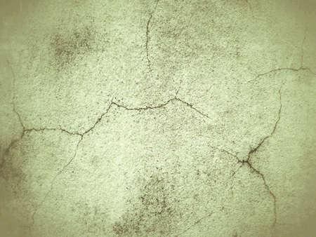 Cracked cement wall grunge sepia background