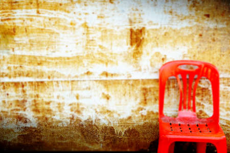 blur background of rustic metal texture, old wall dirty background and red chair, vintage and dark tone Stock Photo