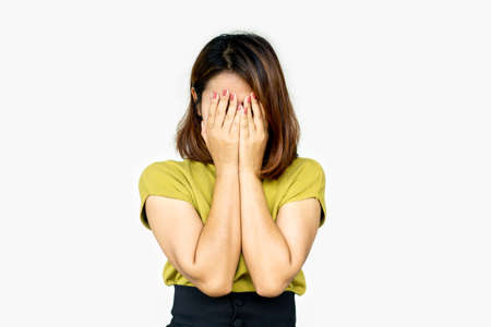depressed Asian woman hand covering her face in deep many thoughts Stock Photo