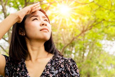 Asian woman having problem sunburn ,melasma, freckles on skin, hand cover her face to protect UV sunlight