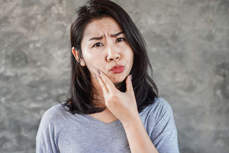 Asian woman having problem with Bell's Palsy/Facial Palsy