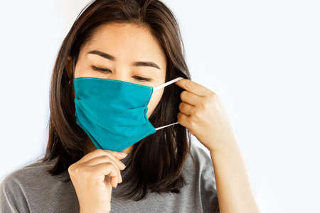 Asian woman wearing face mask to protect the dust and virus from flu
