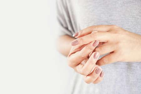 woman suffering from hand and finger pain closeup Standard-Bild