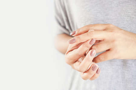woman suffering from hand and finger pain closeup Reklamní fotografie